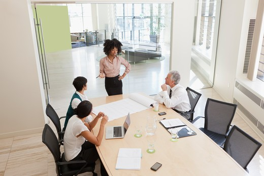 Stock Photo: 4064R-791 Project discussions amongst employees in boardroom
