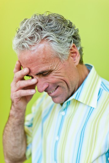 Embarrassed mature businessman : Stock Photo
