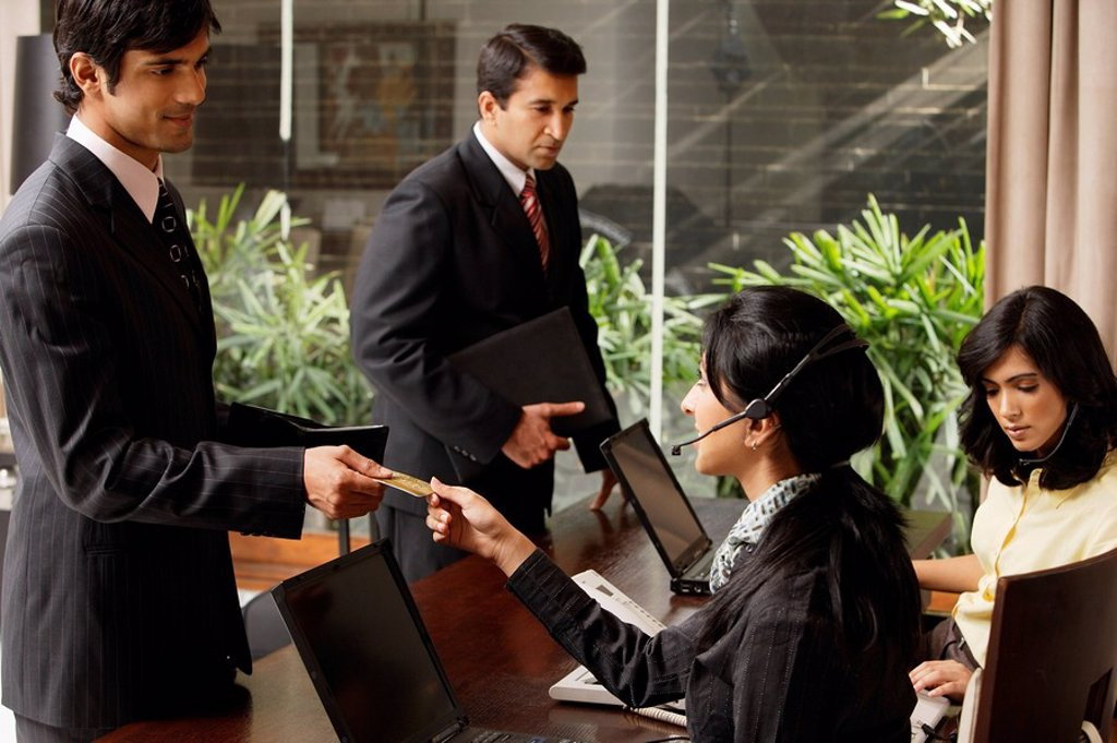 Stock Photo: 4065-10236 checking in at hotel lobby