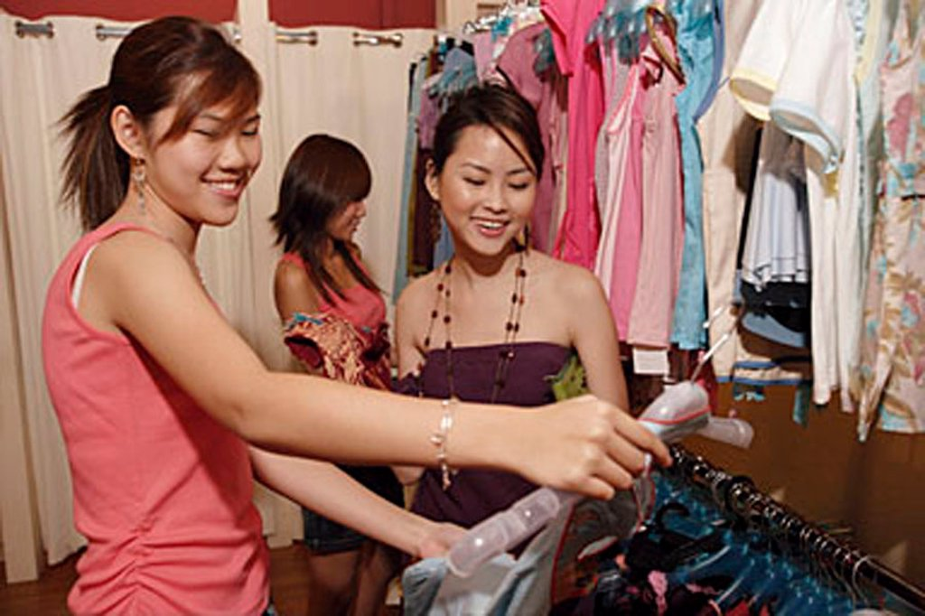 Stock Photo: 4065-10300 Young women shopping in clothing store