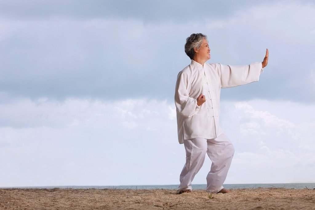 Older woman doing tai chi. : Stock Photo