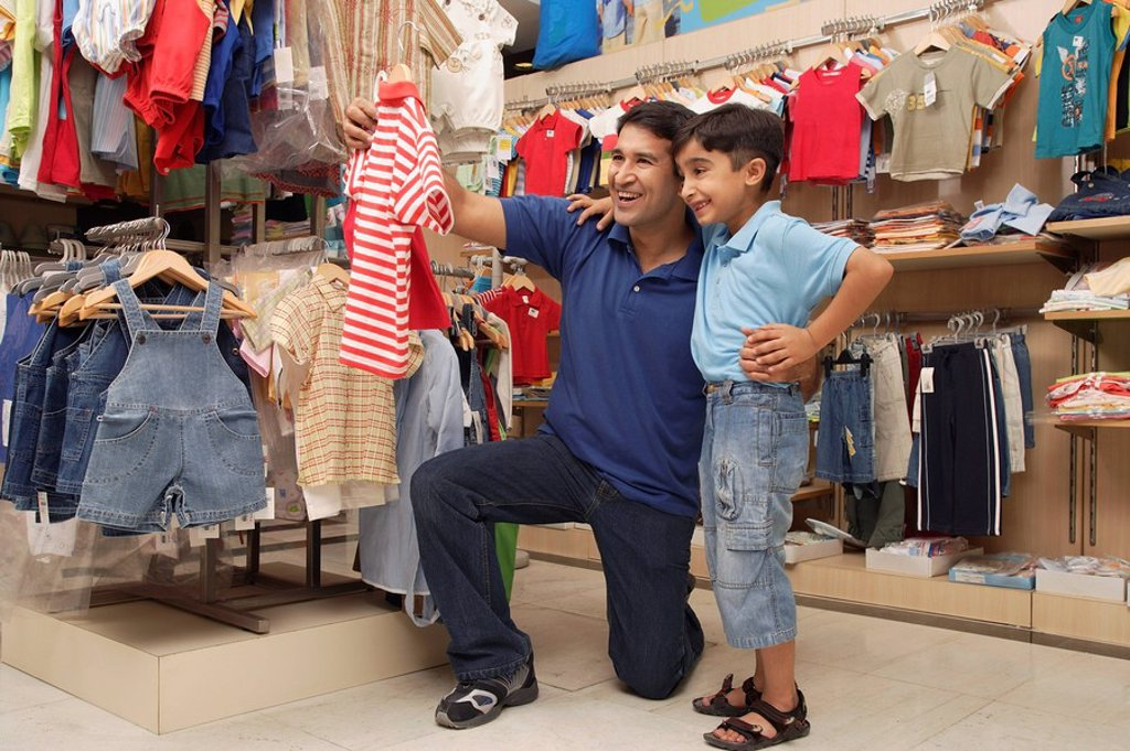 father and son shopping for clothes : Stock Photo