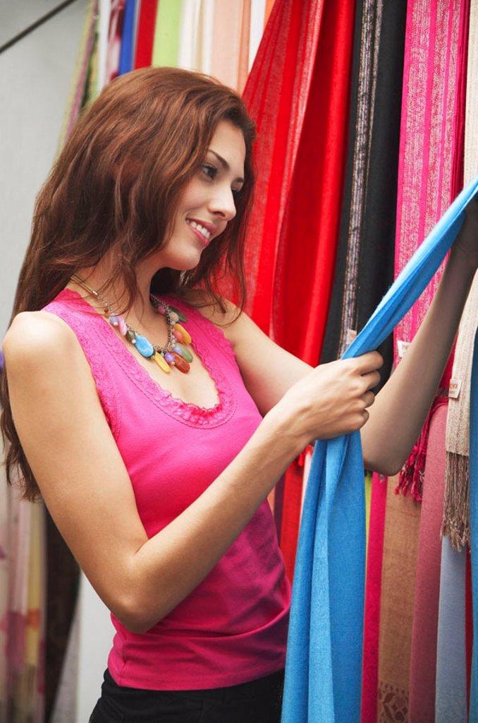 Woman shopping, looking at cloth : Stock Photo