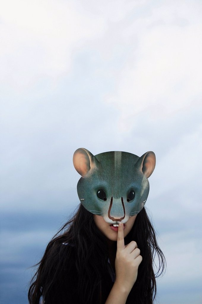 lady with rat mask, one finger on lips : Stock Photo