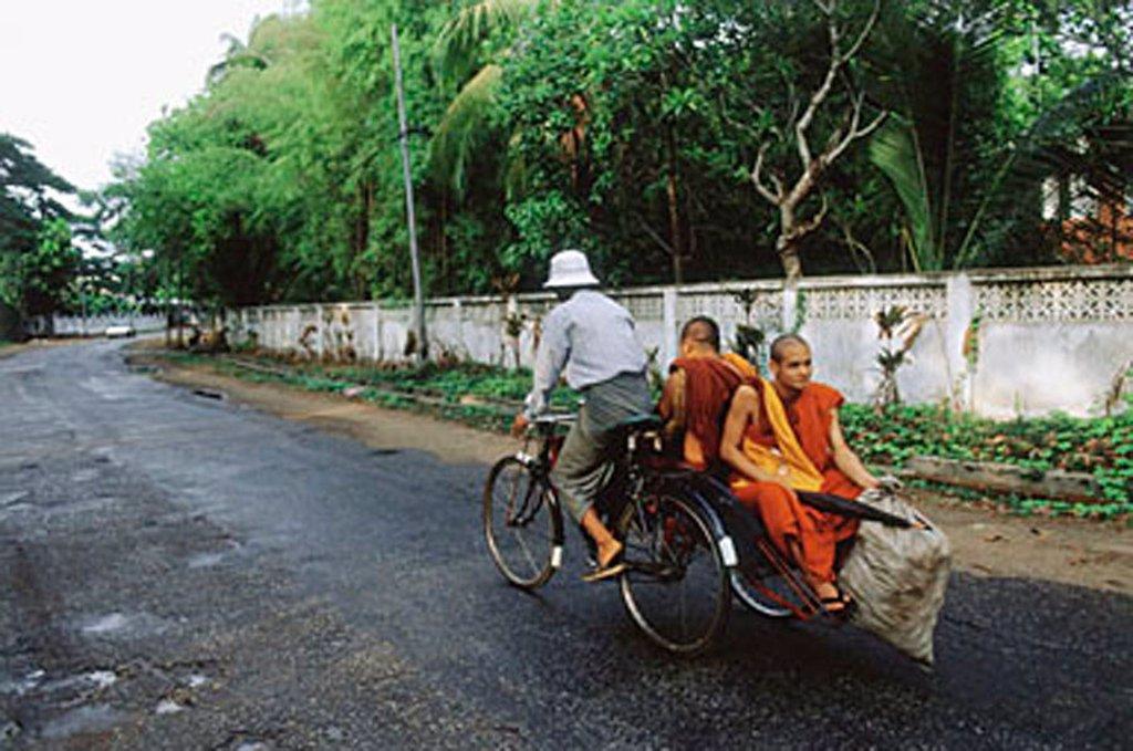 Myanmar (Burma), Yangon (Rangoon), Monks relying on bicycles for transportation. : Stock Photo