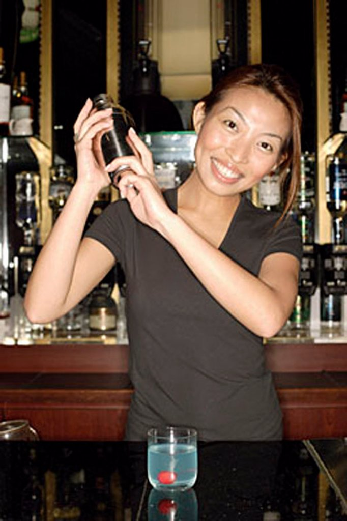 Bartender with cocktail mixer : Stock Photo