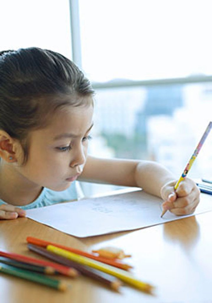 Stock Photo: 4065-12333 Young girl drawing with pencil