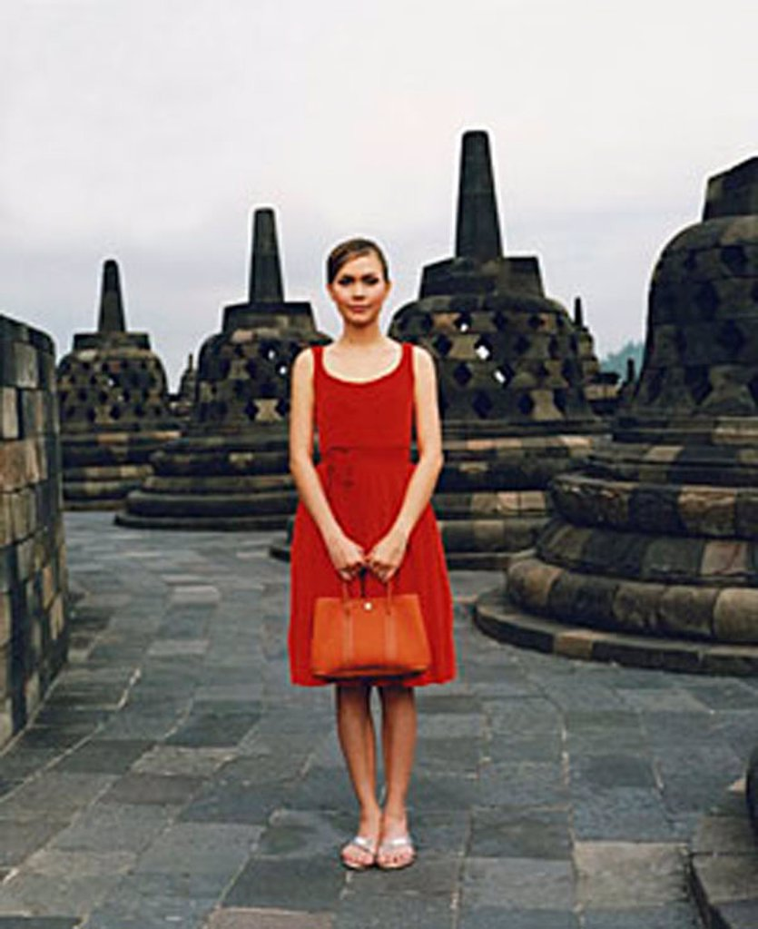 Stock Photo: 4065-12461 Eurasian model holding handbag at Borobudur temple