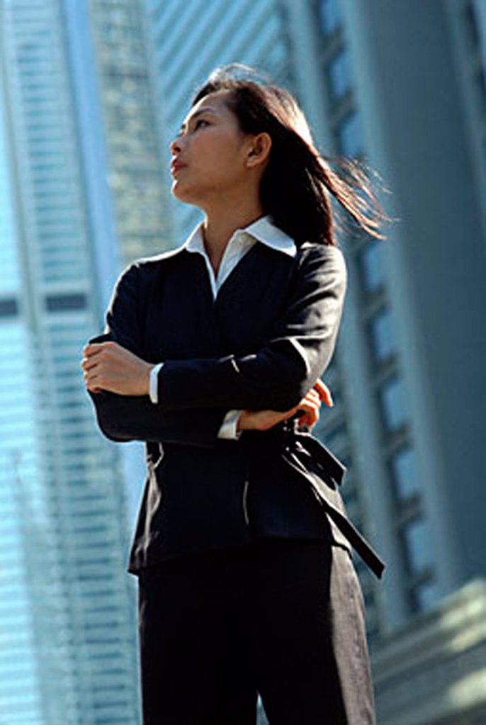 Female executive standing, profile : Stock Photo