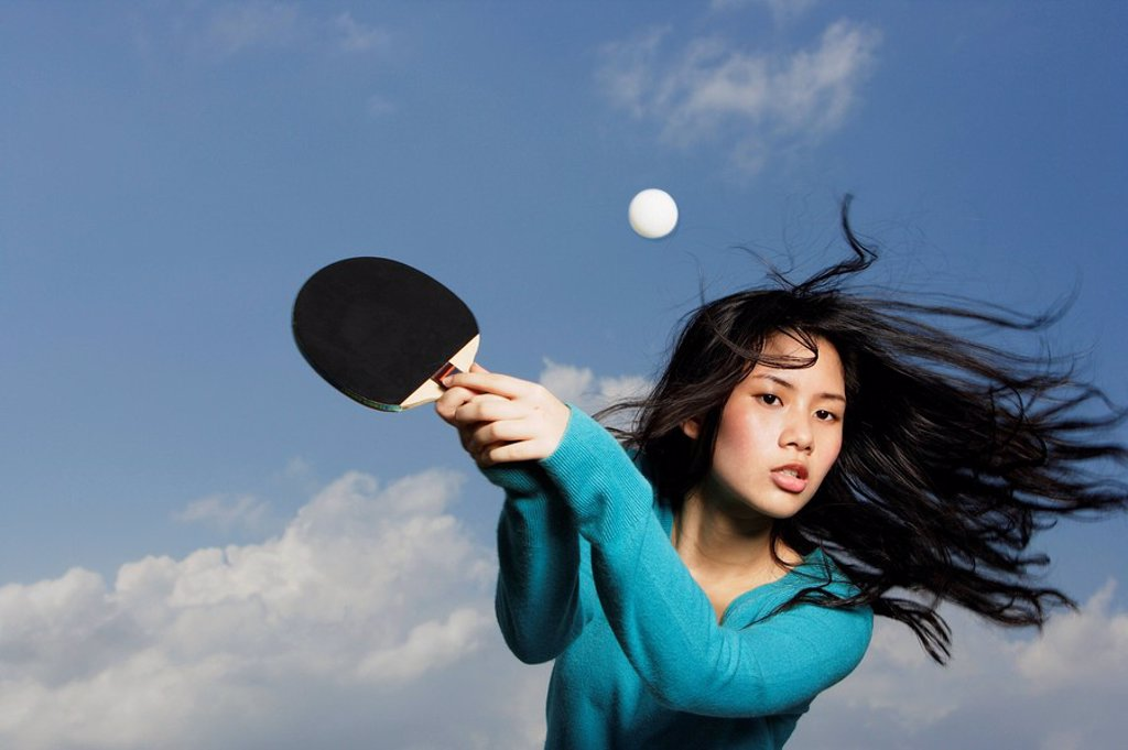 young lady holding ping pong bat : Stock Photo