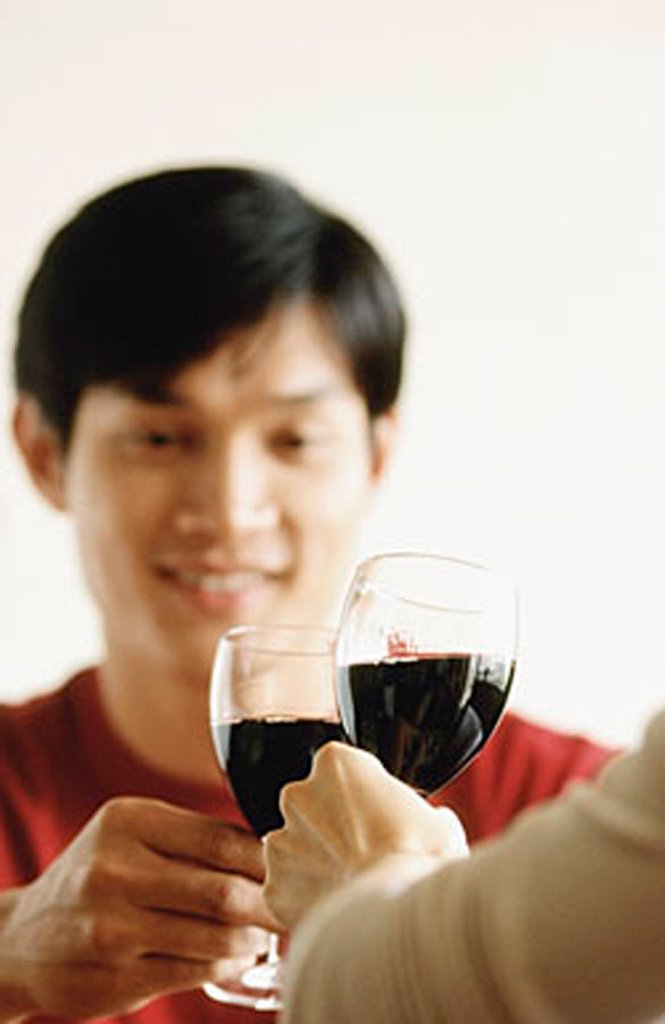Man drinking wine with friend : Stock Photo