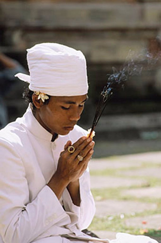 Indonesia, Bali, Hindu priest praying. : Stock Photo
