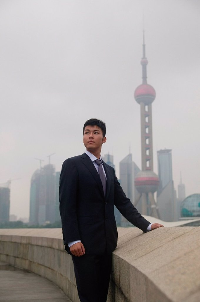 Stock Photo: 4065-14343 Businessman looking away, Oriental Pearl TV Tower in the background