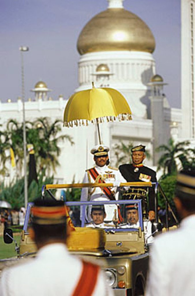 Brunei, Sultan Hassanal Bolkiah watches a military ceremony in honor of his birthday from a reviewing stand. : Stock Photo