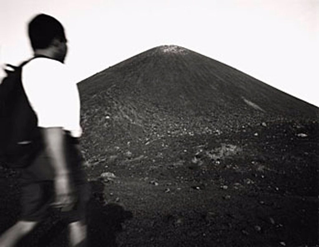 Stock Photo: 4065-14888 Asian male trekker on slopes of Krakatau volcano