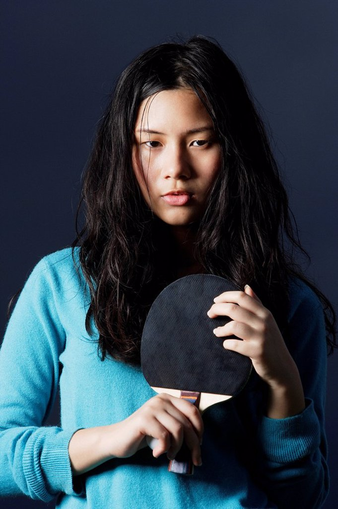 Stock Photo: 4065-1501 young lady holding ping pong bat