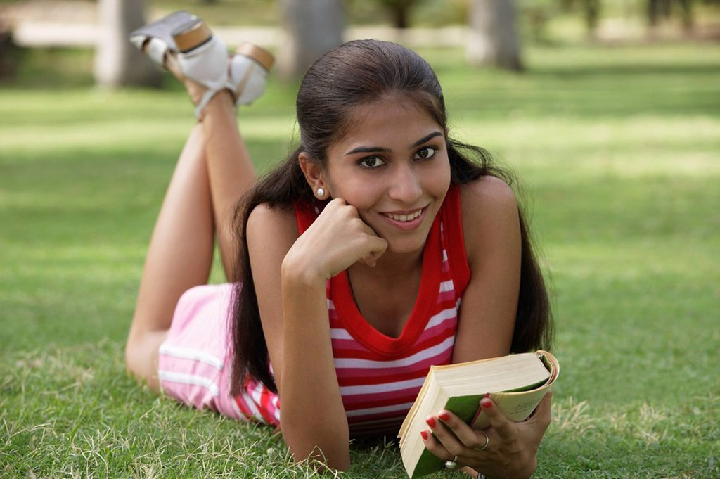 Stock Photo: 4065-15132 Teen girl with book in the park
