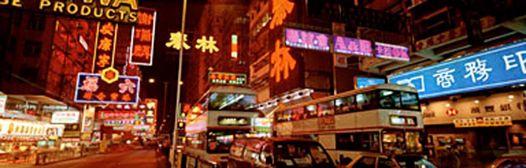 Hong Kong, Kowloon, busy street with neon signs : Stock Photo