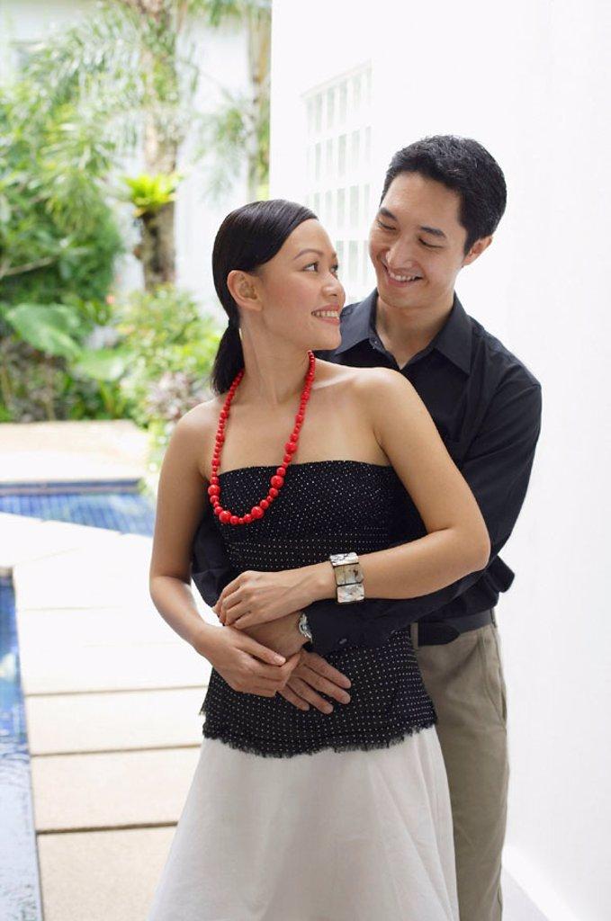 Stock Photo: 4065-15703 Man embracing woman