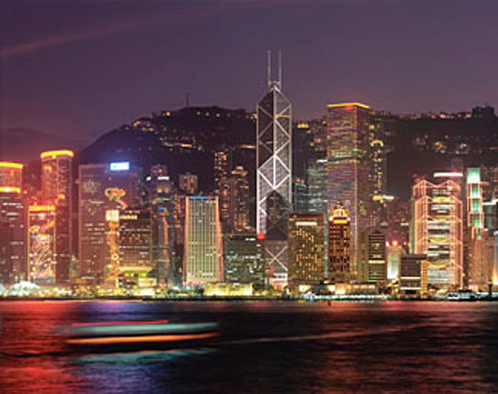 China, Hong Kong skyline, view from across harbor, night view : Stock Photo