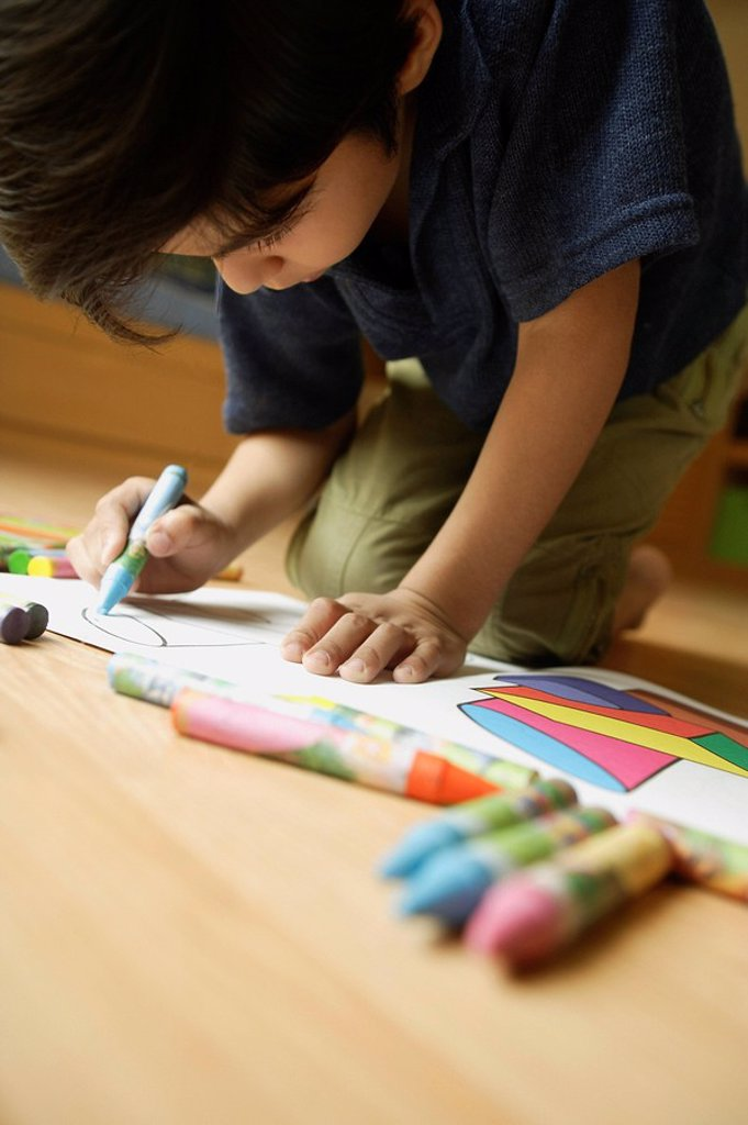Little boy coloring : Stock Photo