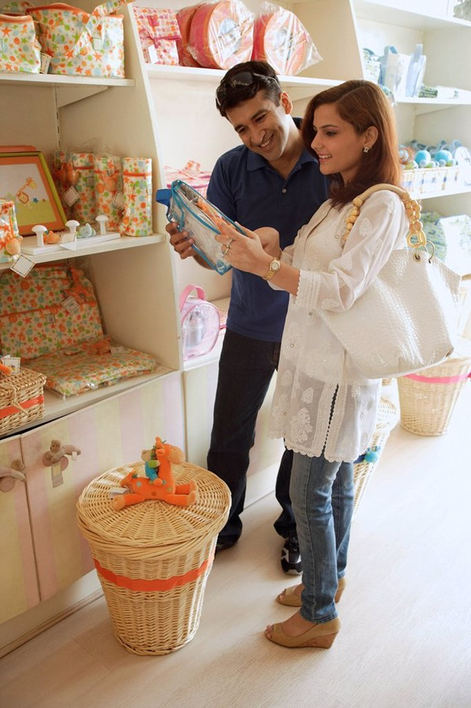 Couple shopping in baby store : Stock Photo