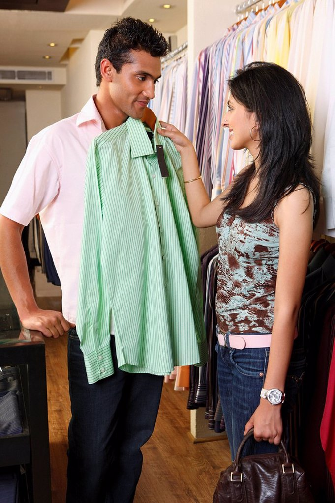 couple shopping for men´s clothing : Stock Photo
