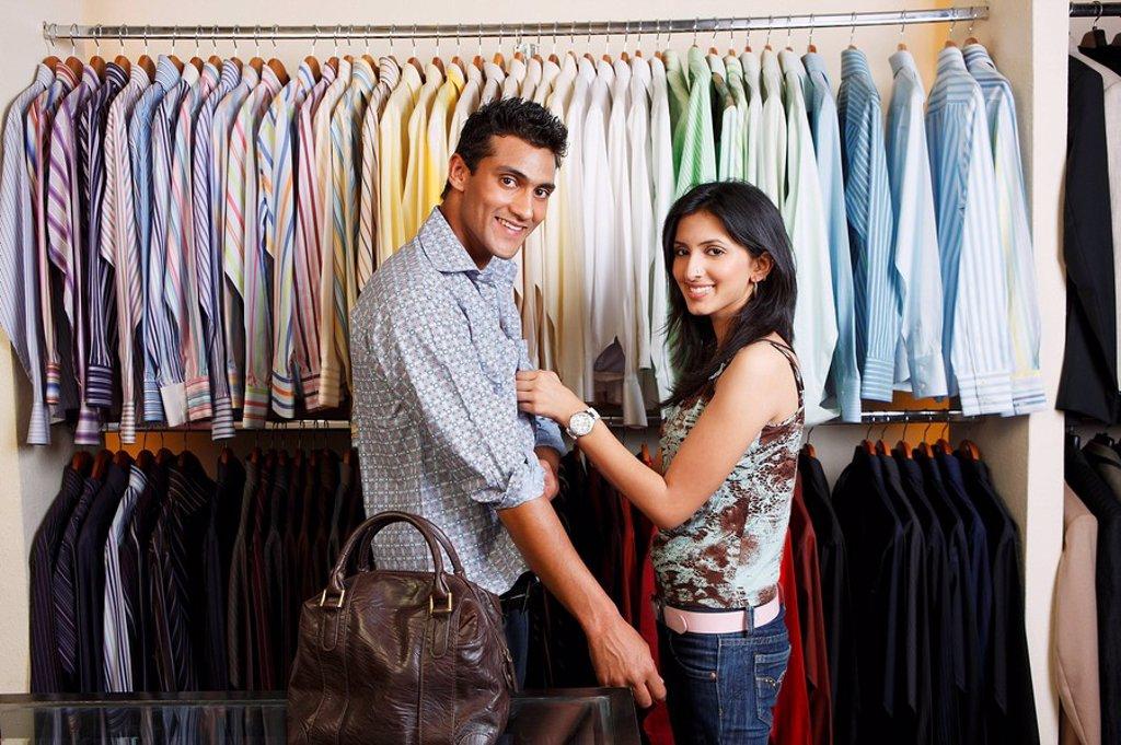 Stock Photo: 4065-18247 couple shopping for men´s clothing