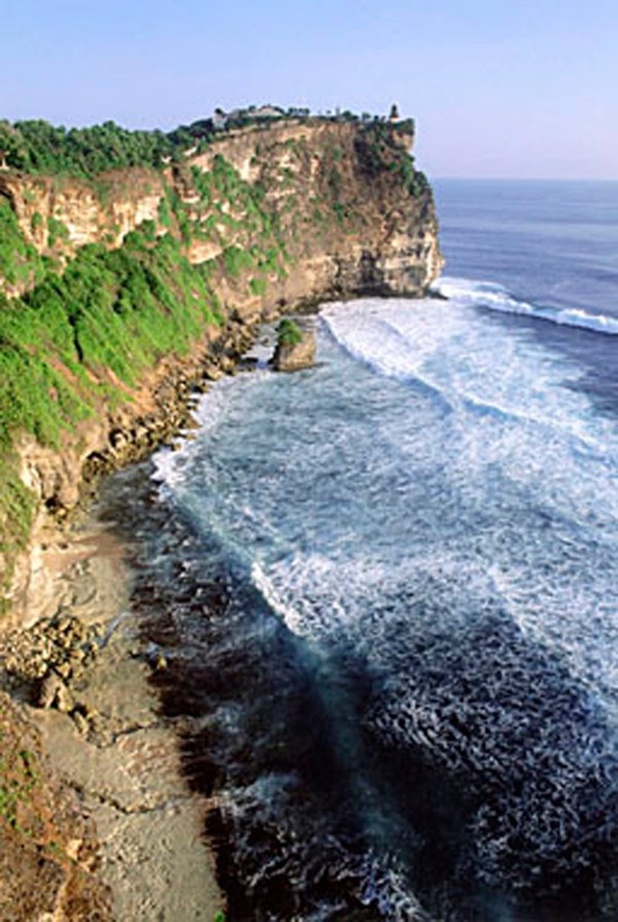 Indonesia, Bali, Uluwatu, View of cliffs and temple. (grainy) : Stock Photo