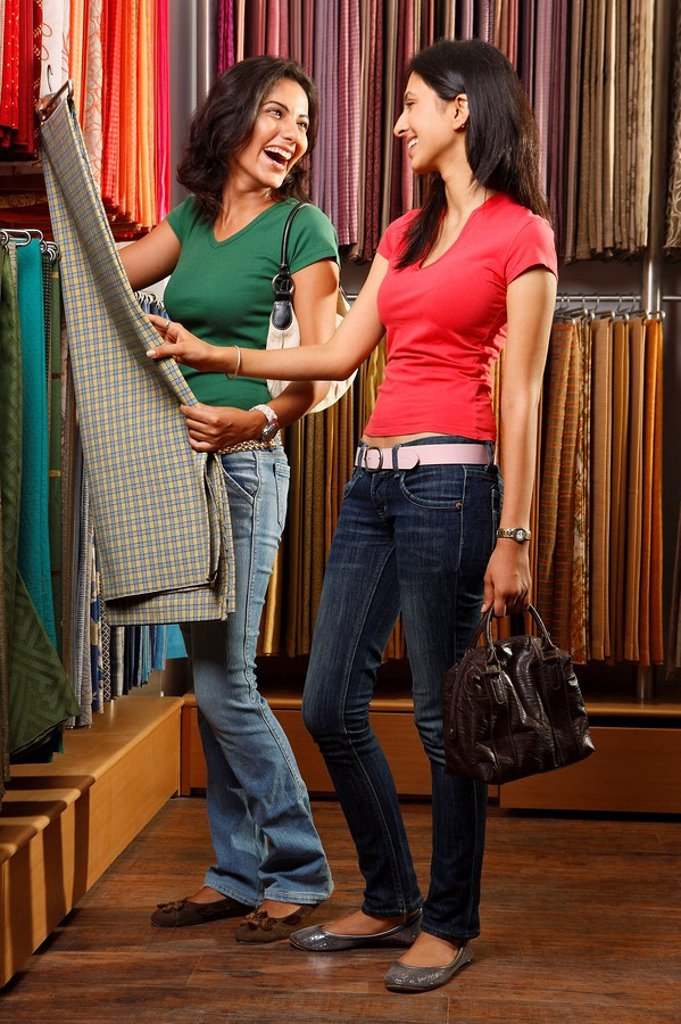 two girls shopping for fabric : Stock Photo