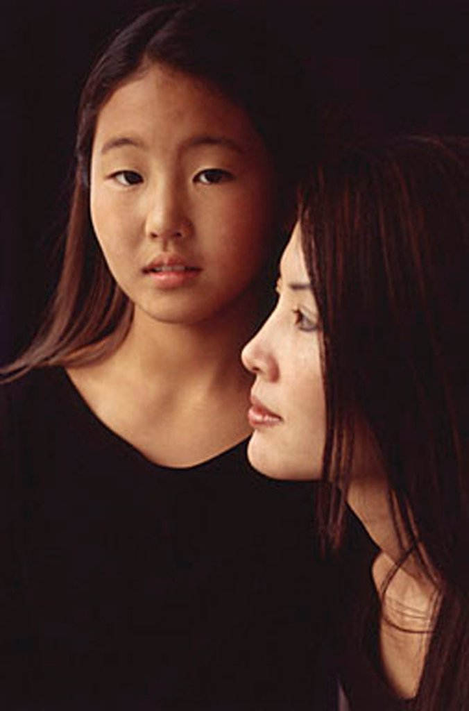 Mother and daughter, looking at camera and looking away : Stock Photo