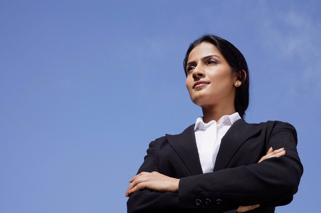 Stock Photo: 4065-19373 businesswoman with arms folded