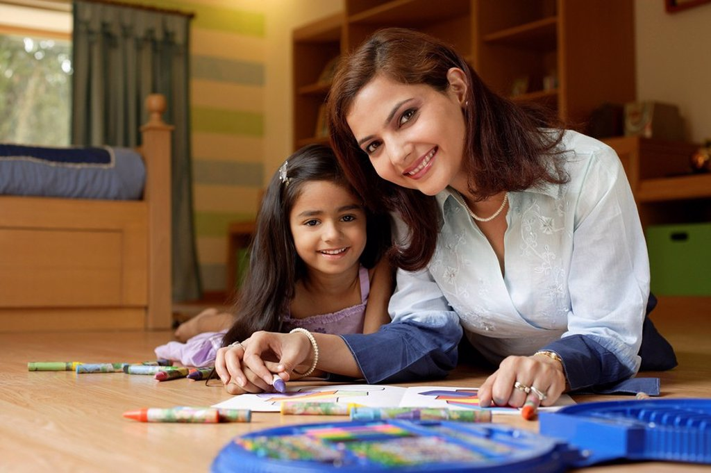 mother and daughter coloring : Stock Photo