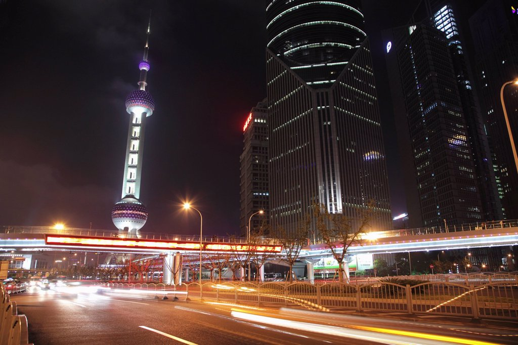 Stock Photo: 4065-21619 Shanghai streets at night with The Oriental Pearl Tower in background