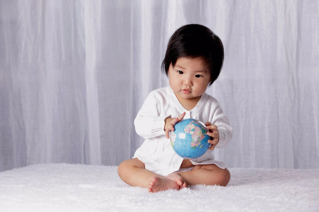Stock Photo: 4065-21898 Chinese baby holding small globe