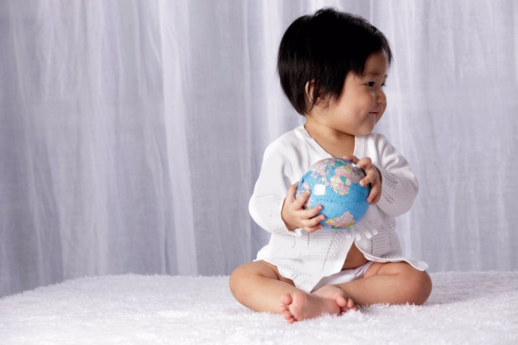 Stock Photo: 4065-21953 Chinese baby holding small globe
