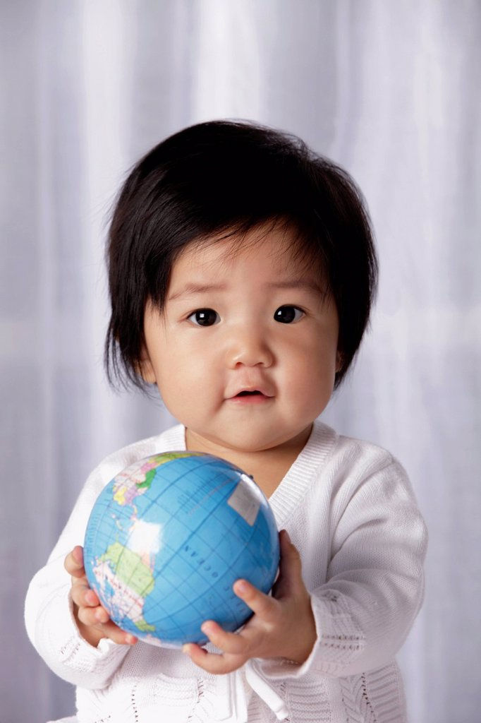 Stock Photo: 4065-21977 Head shot of Chinese baby holding small globe