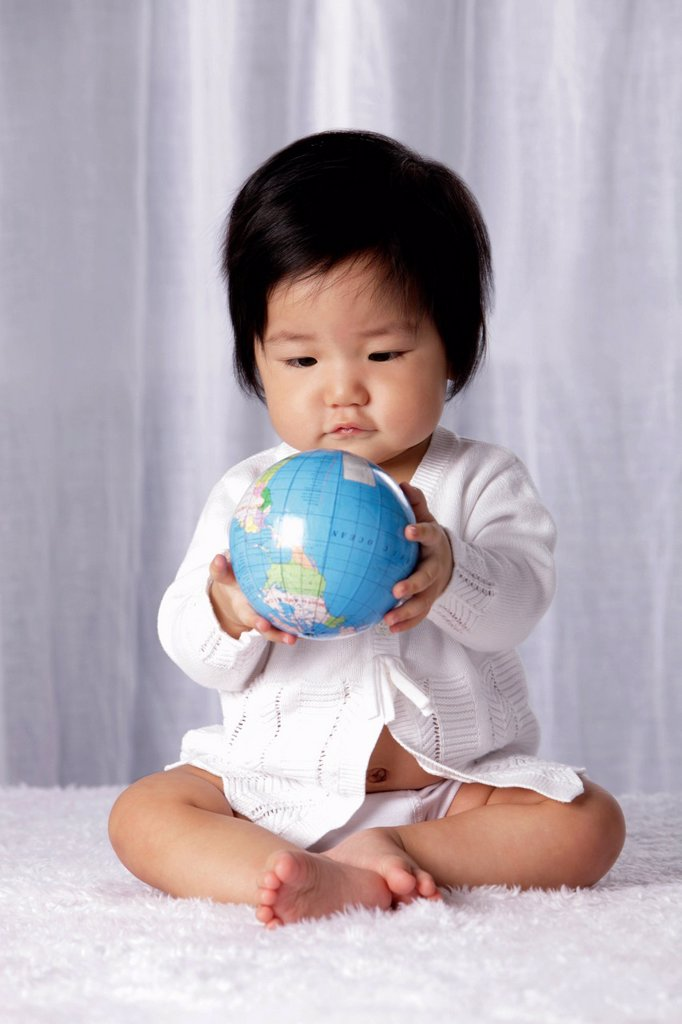 Stock Photo: 4065-22064 Chinese baby holding small globe