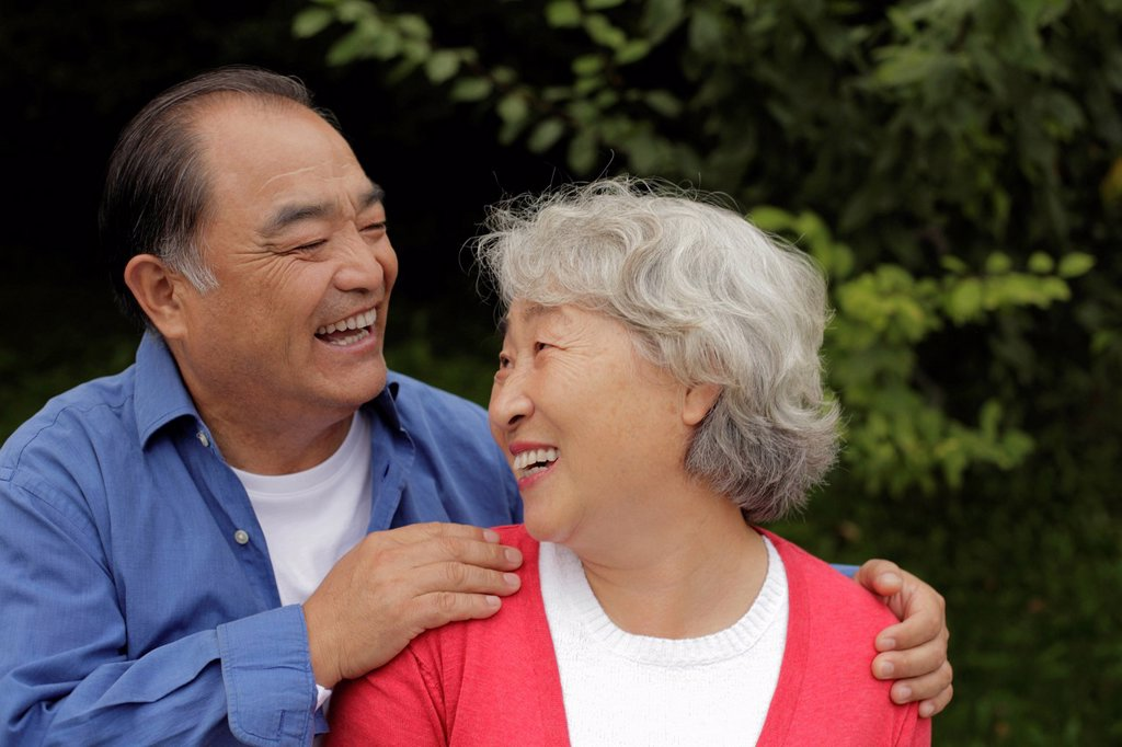 Older couple laughing together : Stock Photo
