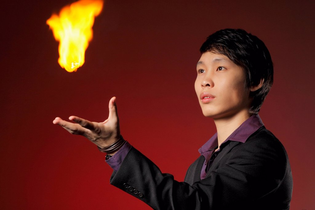Stock Photo: 4065-22750 A magician levitates a ball of fire