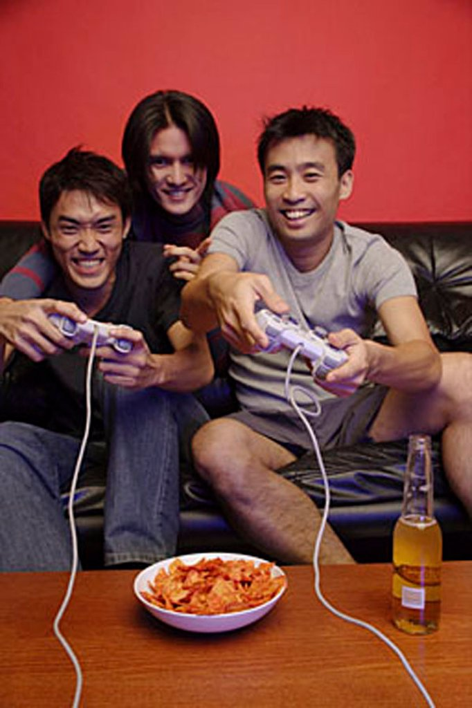 Stock Photo: 4065-2636 Young men playing with video games