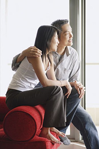 Stock Photo: 4065-2638 Couple at home, side by side, looking away
