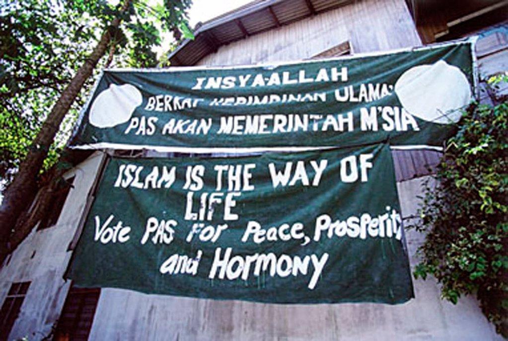 Stock Photo: 4065-2749 Malaysia, Kelantan, Kota Bahru, banner of Pan-Malaysian Islamic Party.