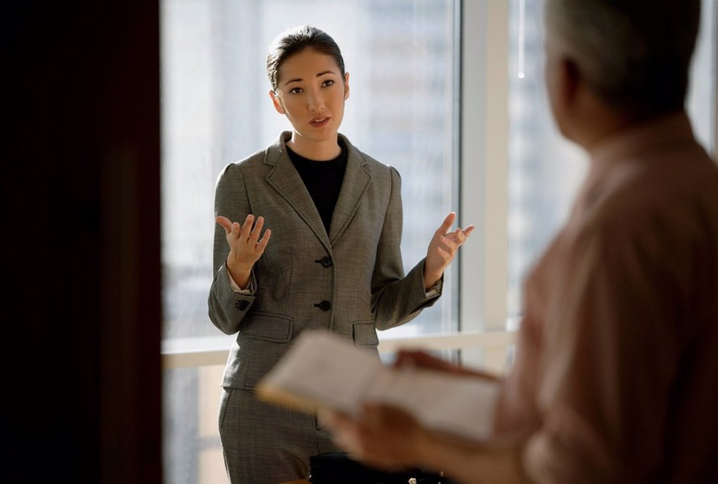 woman talking to colleague : Stock Photo