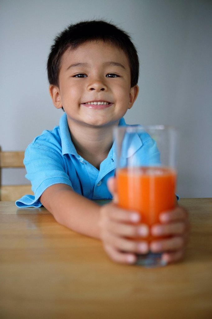 Little boy with glass of juice : Stock Photo