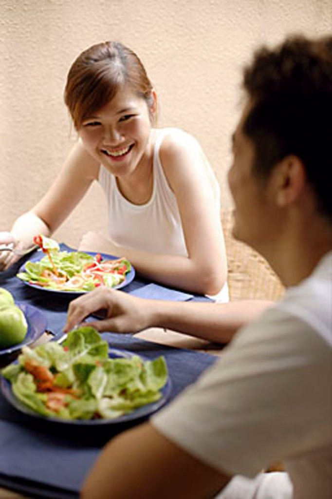 Couple having lunch at home : Stock Photo