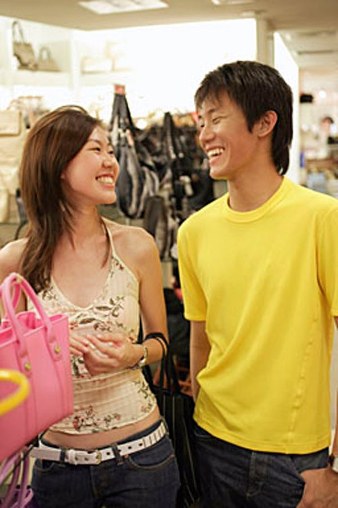 Couple shopping, woman holding a bag : Stock Photo
