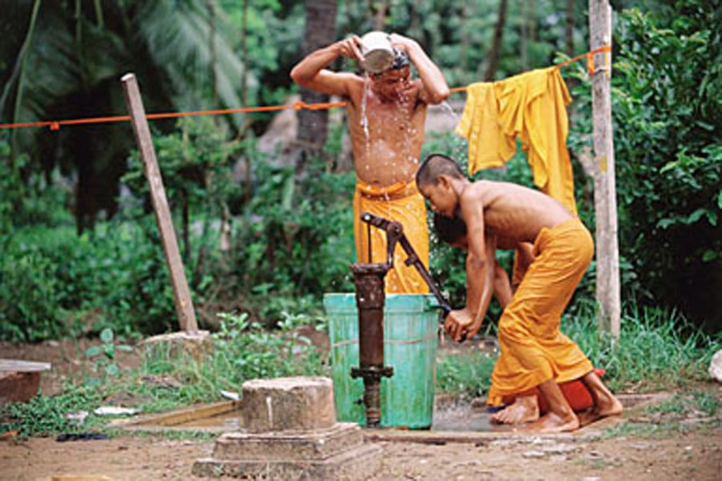 Stock Photo: 4065-5323 Vietnam, Mekong Delta region, Bac Lieu, Buddhist monks bathing at water pump.