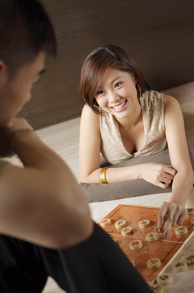 Couple playing Chinese chess : Stock Photo