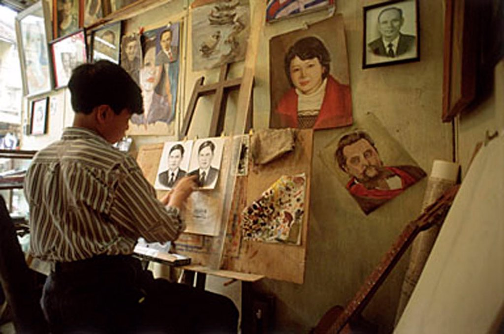 Vietnam, Hanoi, man painting in studio : Stock Photo